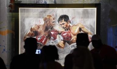 7777543692_la-toile-the-superfight-de-l-artiste-richard-slone-representant-les-boxeurs-floyd-mayweather-et-manny-pacquiao-le-1er-mai-2015